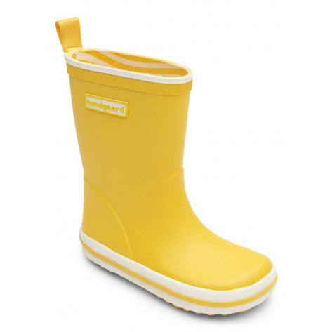 A side view of a Bundgaard's yellow Sunflower Classic Rubber Boot children's barefoot boots