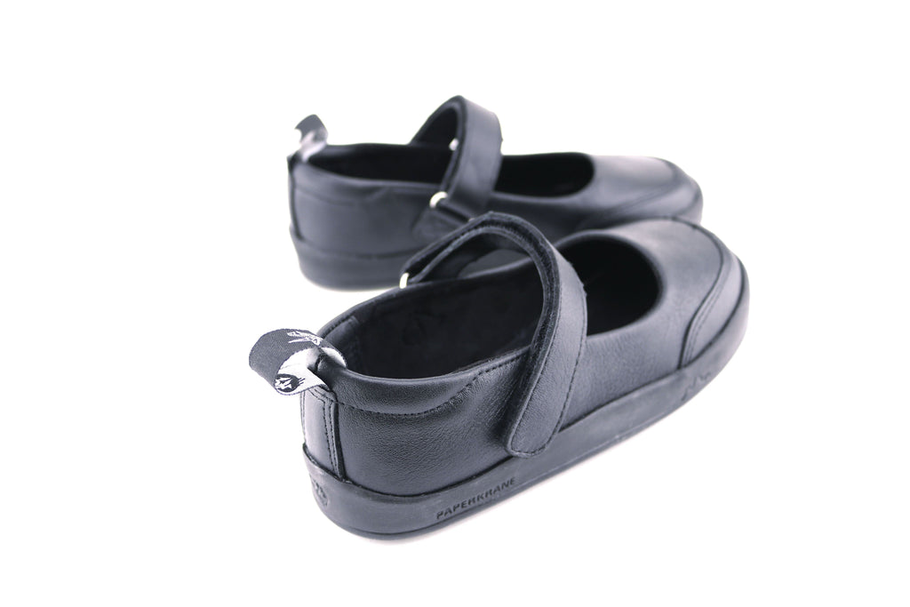 The back of a black pair of PaperKrane's Atlas children's barefoot shoe