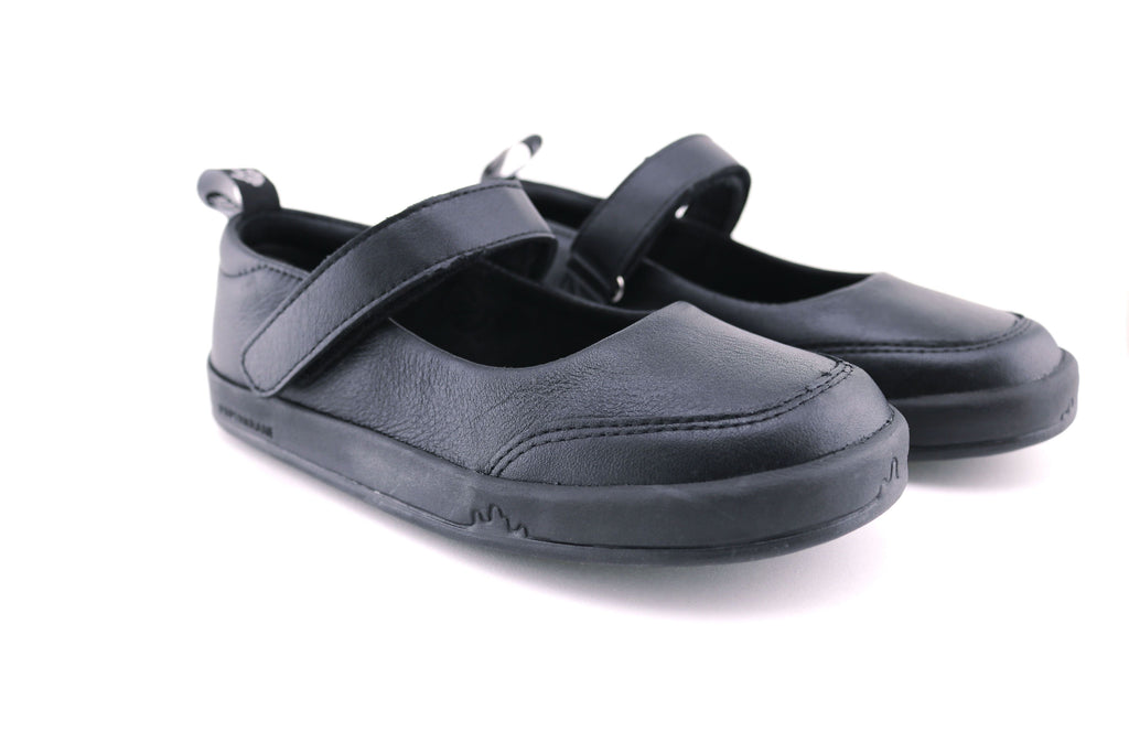 The front of a black pair of PaperKrane's Atlas children's barefoot shoe