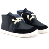 A front view of PaperKrane's Slick Black children's barefoot shoe in black