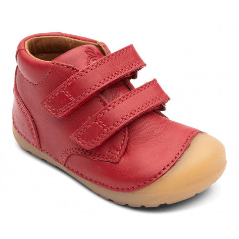 A side view of a red Petit Velcro children's barefoot shoes