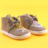 A front view of PaperKrane's Tie Dye children's barefoot shoe in tan