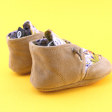 A side view of PaperKrane's Tie Dye toddler barefoot shoe in tan