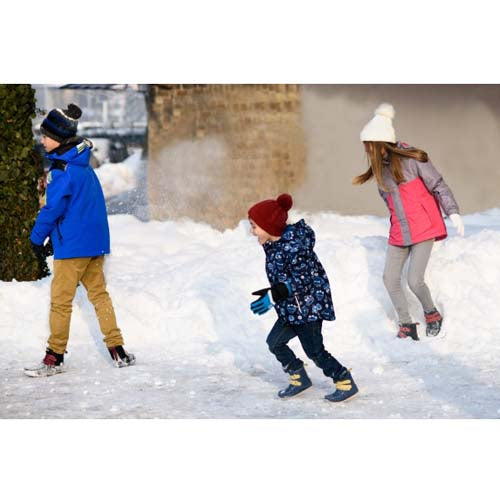 photo of kids playing in the snow wearing zeazoo yeti minimalist boots for kids