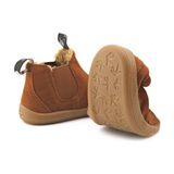 A view of the flexible sole of PaperKrane's BRRR Boots children's barefoot boot in brown