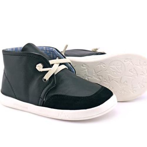A view of the sole of PaperKrane's Slick Black children's barefoot shoe in black healthy shoes for kids