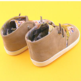 A back view of PaperKrane's Tie Dye children's barefoot shoe in tan