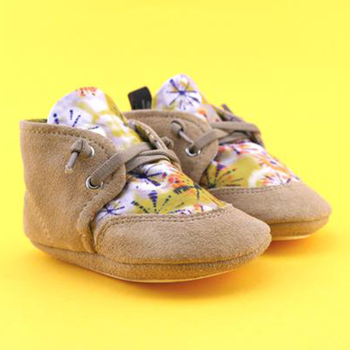 A front view of PaperKrane's Tie Dye toddler barefoot shoe in tan