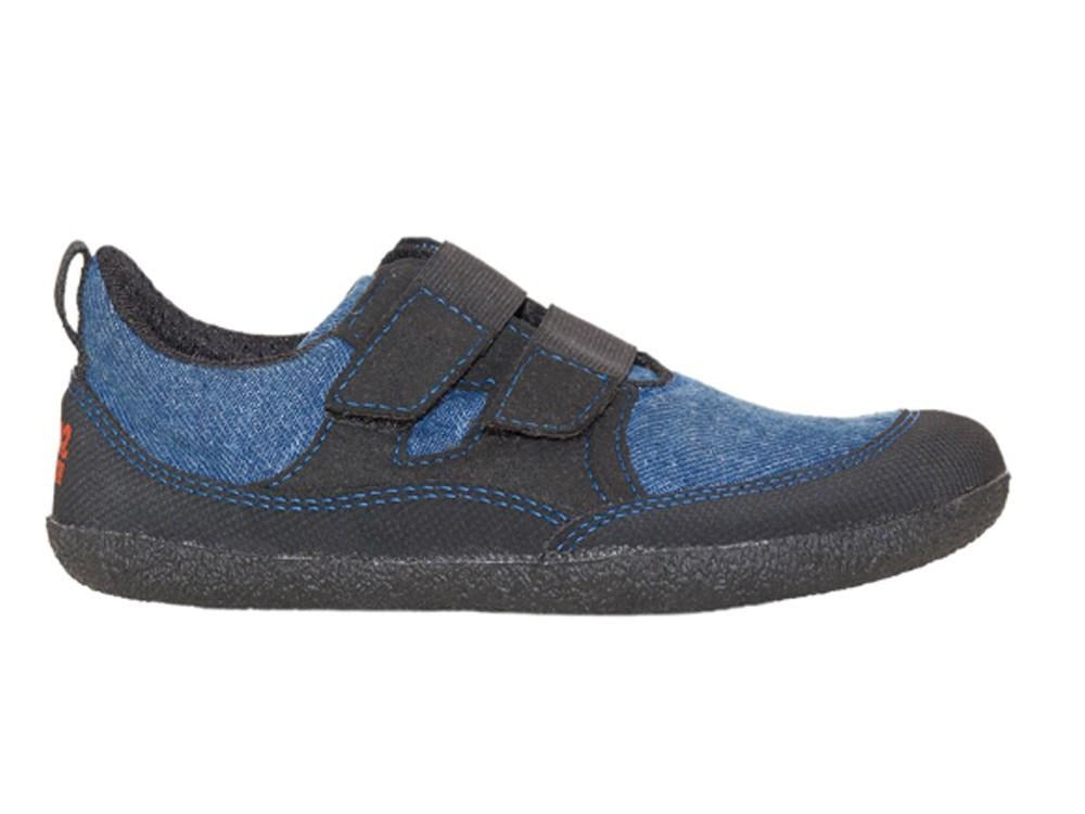 A side view of a blue Puck children's barefoot shoe by Sole Runner