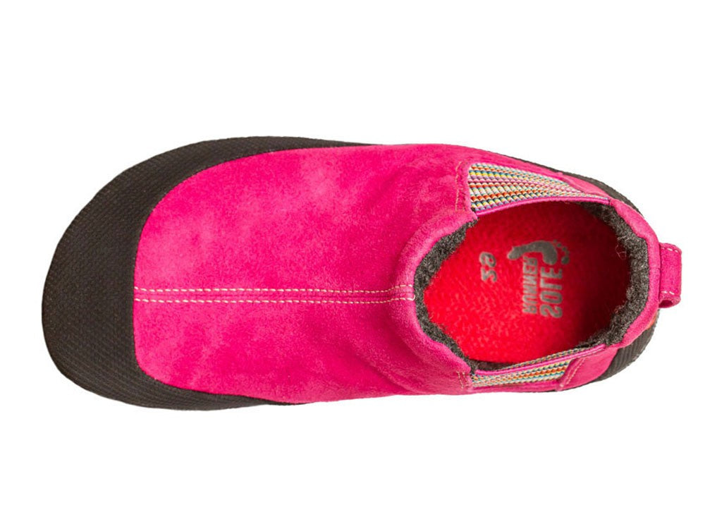 A top-down view of a pink Portia children's barefoot shoe by Sole Runner