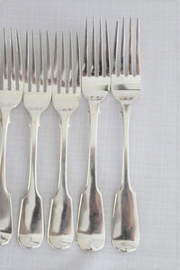 A wonderful set of 7x British made hallmarked sterling silver dinner forks (470.23g)