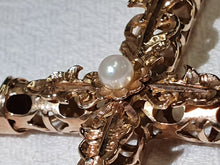 Load image into Gallery viewer, An ornate 14ct gold cross with a pearl centre piece