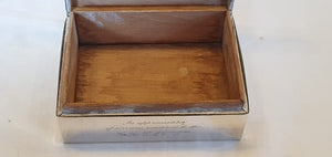 A hallmarked sterling silver engraved cigar/ cigarette box