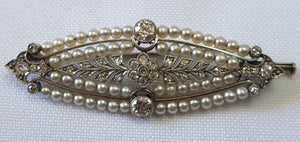 A vintage Art Deco diamond and pearl brooch set in gold