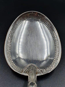 A large 25cm ornate hallmarked 900 solid silver spoon. 73.18grams.