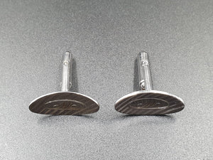 A pair of stamped sterling silver bullet back gents cufflinks engraved with an M