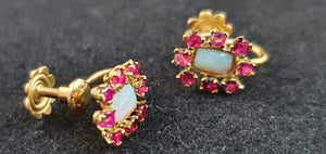 A pair of vintage 14ct gold screw on earrings and necklace clasp with colourful Rubies