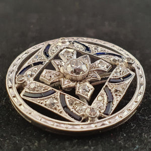 A magnificent vintage Art Deco Diamond & Sapphire brooch set in Platinum with 60 diamonds and 16 Sapphires