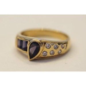 A beautiful and unique 18 karat gold ring decorated with diamonds and amethysts.