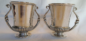 An antique set of elegant (1927) hallmarked sterling silver double handled goblets (850grams)