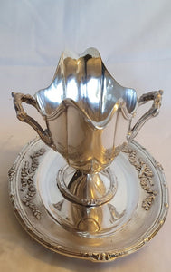An exceptional, graceful and very ornate antique sterling silver (1800s) double handled plated gravy boat.