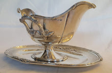 Load image into Gallery viewer, An exceptional, graceful and very ornate antique sterling silver (1800s) double handled plated gravy boat.