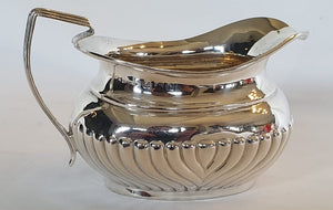 "A stunning antique (1907) British hallmarked ""H.J.Cooper & Co"" sterling silver teapot and creamer"