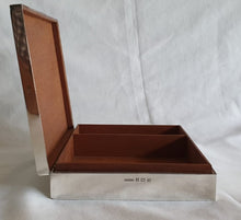 "Load image into Gallery viewer, An exquisite wood lined hallmarked (1961) ""H Bros"" sterling silver cigar box."