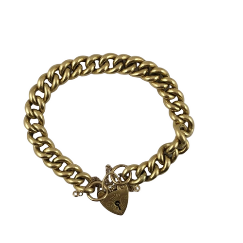 A thick 9ct gold chain link bracelet with a heart lock