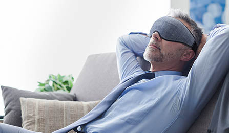 man_at_work_relaxing_with_a_sleep_mask