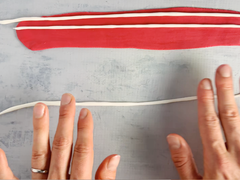 Roll more white fondant to make American flag stripes