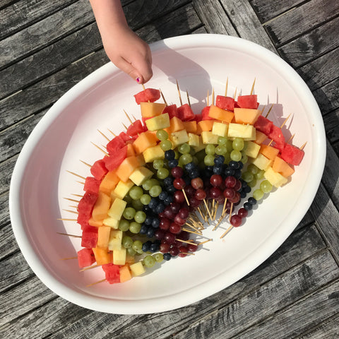 Fruit skewers made into a rainbow