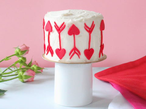 Heart arrows made out of fondant for Valentine's Day cake decoration