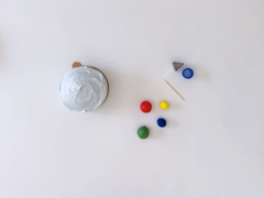 Ingredients and equipment to decorate a golf themed mini cake with fondant