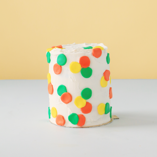 Tall mini cake with dots.