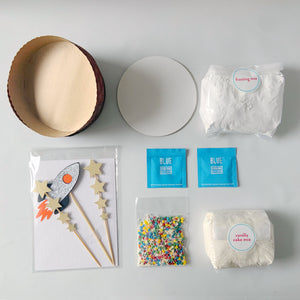 Baking supplies for rocket cake kit with cake topper