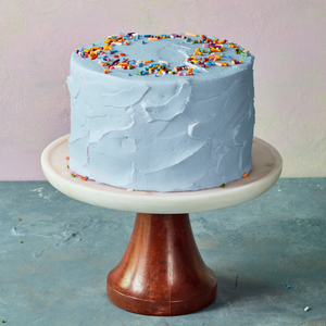 Blue birthday cake with sprinkles