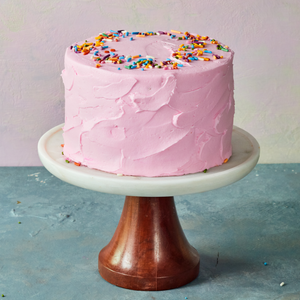 Pink birthday cake with sprinkles
