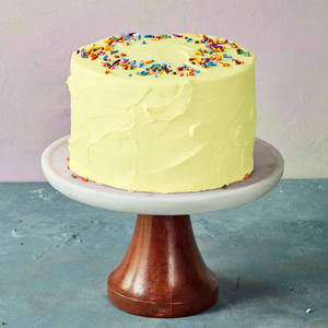 Yellow birthday cake with sprinkles