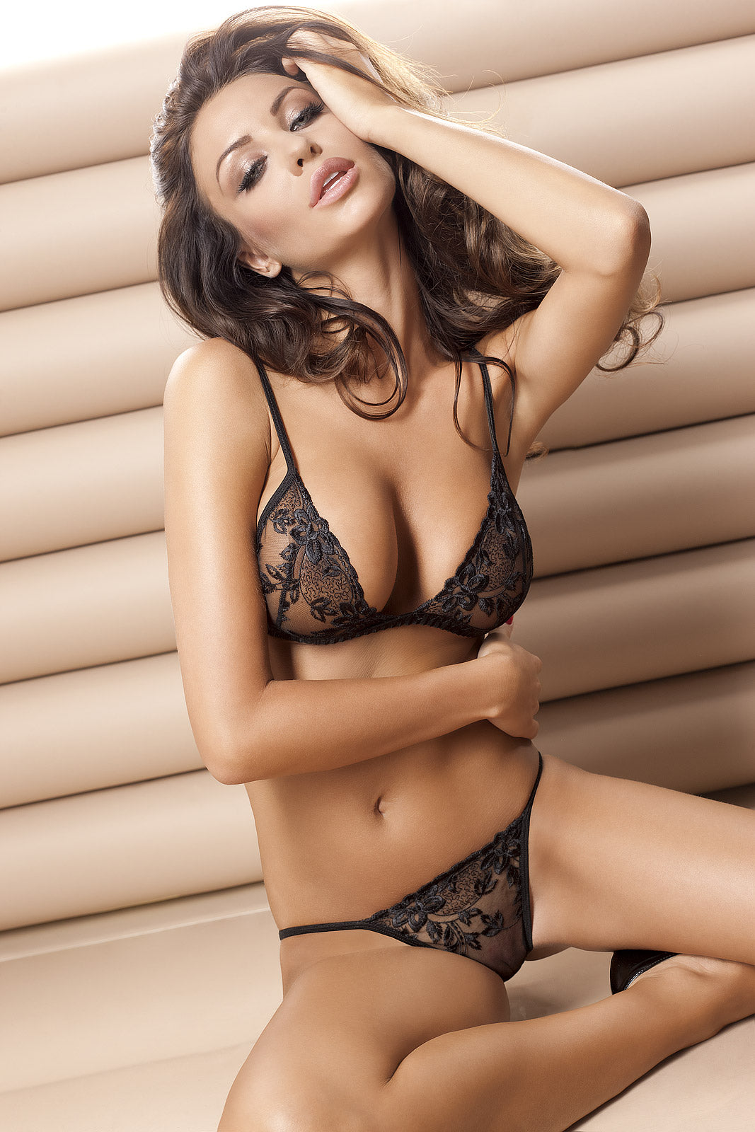 Black lace bralette with matching thong