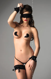 Cuffs, mask, pasties, thong, and garter