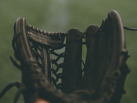 Baseball player holding their glove out
