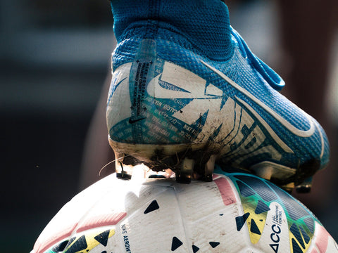Person's foot on soccer ball