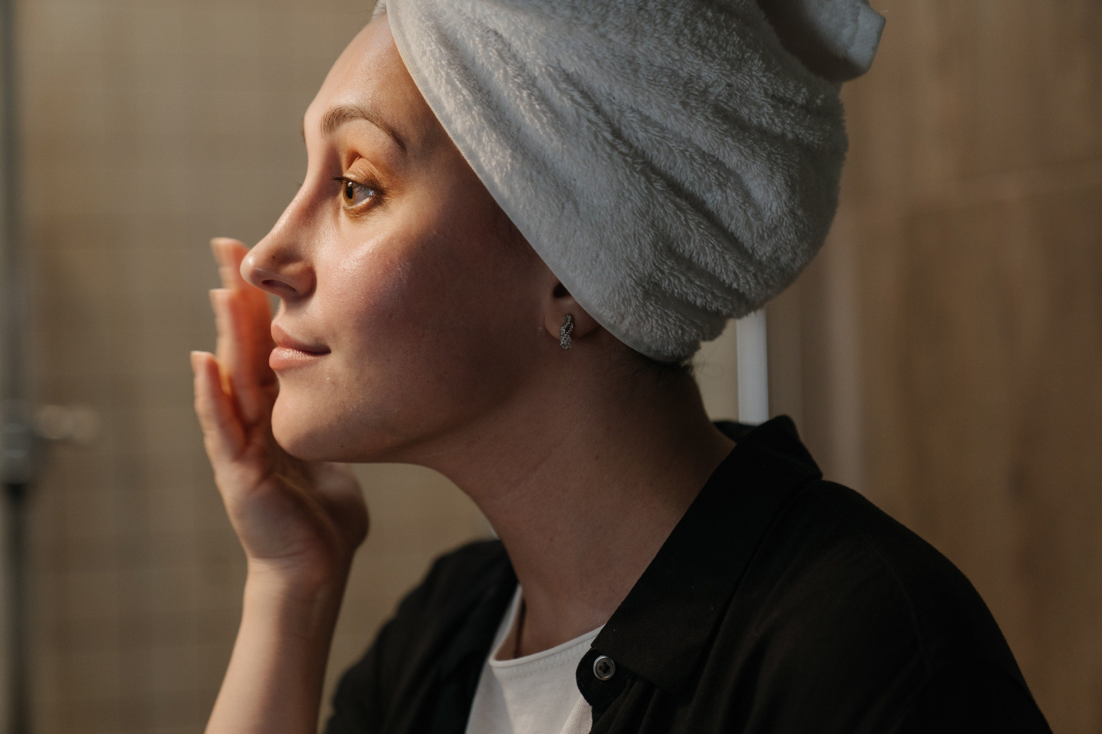 Applying nighttime products to face before sleep