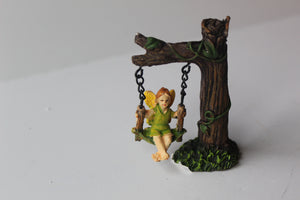 Fairy swinging from a tree branch