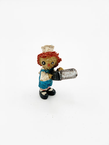 Doll with chainsaw