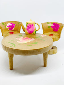 Table, 2 chairs and teapot