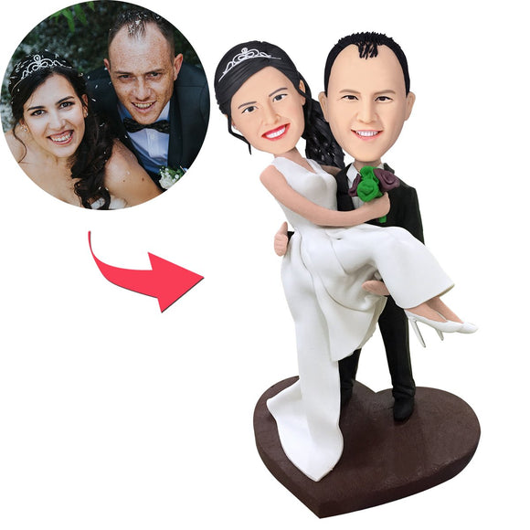 Custom Bridegroom Holds The Bride Bobbleheads With Engraved Text