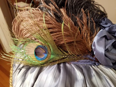 feathers attached to hat with hand stitching