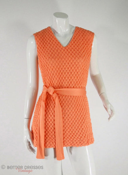 Sears 1960s peach crochet mini dress at Better Dresses Vintage. Knot at hip.
